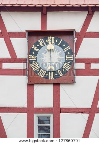 detail of a historic bakehouse with turret clock in Forchtenberg a small town in Hohenlohe located in Southern Germany