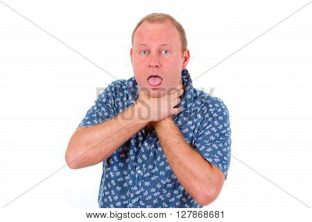 Breathless man 30-35 years in shirt hold himself for the neck. Isolated on white background. Negative human emotion facial expression