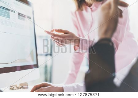 Coworking team.Startup manager work process new project.Photo young business woman showing report document monitor screen. Desktop computer on table, reflection. Blurred, film effect.