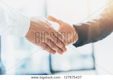 Business partnership meeting. Photo businessmans handshake. Successful businessmen handshaking after good deal. Horizontal, blurred poster