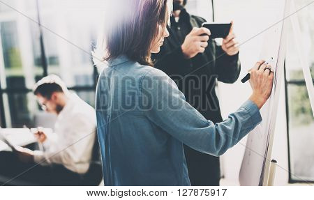 Business crew meeting. Photo account managers working with new startup project. Manager holding modern smartphone hands. Idea presentation, analyze marketing plans. Blurred