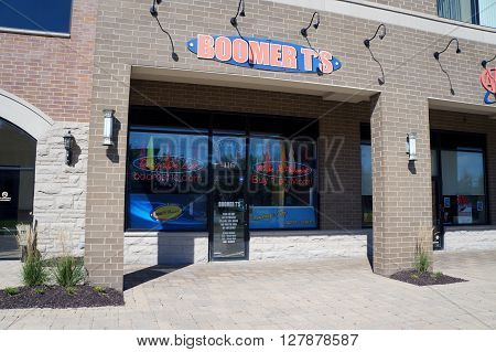 PLAINFIELD, ILLINOIS / UNITED STATES - SEPTEMBER 20, 2015: One may have designs printed on t-shirts at Boomer T's in the Town Square on Lockport Street in Plainfield.