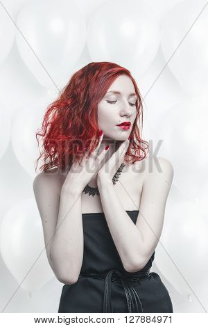 redhead young woman portrait on white baloon background