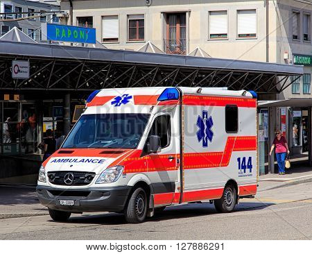 Schaffhausen, Switzerland - 26 August, 2015: an ambulance van standing on Bahnhofstrasse street at the Schaffhausen train station. In Switzerland the phone number for the ambulance is 144 as painted on the van.