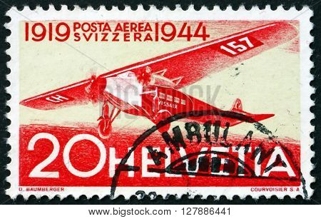 SWITZERLAND - CIRCA 1944: a stamp printed in the Switzerland shows Fokker Airplane 25th Anniversary of the 1st Regular Air Route in Switzerland circa 1944