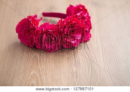 Wraith Of Artificial Pink Rose Flowers On Wooden Surface