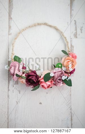 Pink Flowers Wraith Or Tiara On White Wooden Background