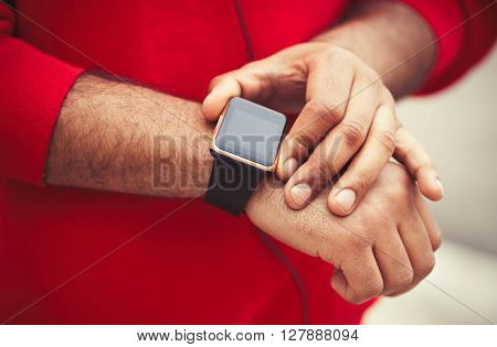 Hands Of African Male Using Trendy Smart Watch