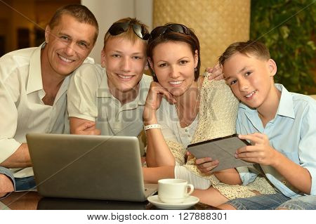 happy family  with laptop at the table