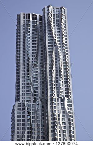 Beekman Tower 76-story skyscraper designed by architect Frank Gehry in the New York City borough of Manhattan. 8 Spruce Street NYC USA NEW YORK CITY - AUGUST 18 2015: Spruce Street skyscraper know as the Beekman Tower or or New York by Gehry. The modern r