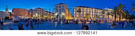 Split Croatia - August 25 2014: City of Split square evening panorama Dalmatia Croatia. Many tourists visit famous new Riva waterfront. It is a part of Diocletian palace UNESCO world heritage site.