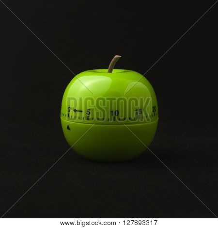 kitchen timer in the form of green apple