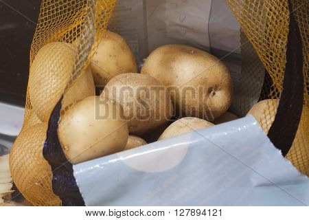 Yellow potatoes in an open transport bag