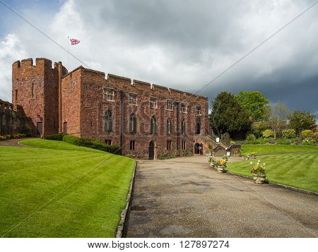 Castle with sandstone walls and vibrant gardens, Shrewsbury, Shropshire, England, UK.