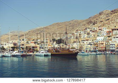 KALYMNOS GREECE - JULY 2015: Boats in greek harbor offered for rent.Vintage effect.