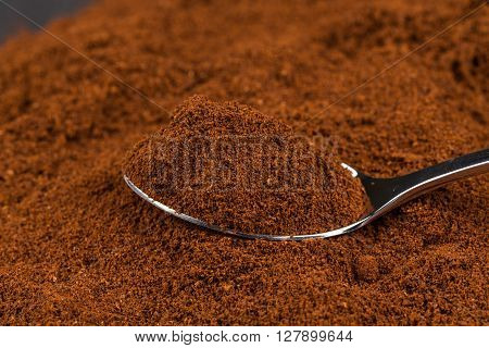 Ground Coffee And A Metal Spoon