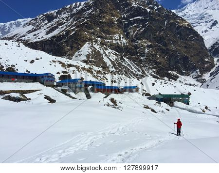 Trekker in the mountains, summer day in Himalayas,  Annapurna base camp, Nepal