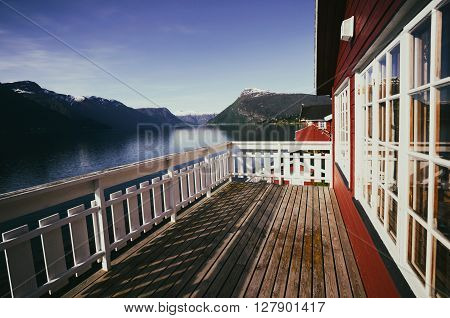 benches for rest at the norwegian terrace house with mountains norway