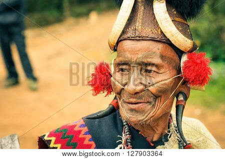 Old Man With Plugs In Ears