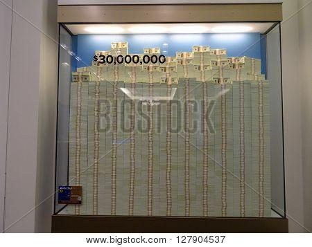 DENVER COLORADO - JULY 7: Stack of Hundred dollar bills in glass display case equally 30 million dollars inside United States Mint in Denver Colorado. July 7 2015.