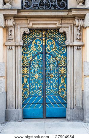 Old decorative blue doors with golden finished decorations