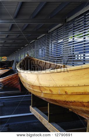 A Yellow wooden boat.