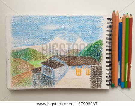 House and mountains on a white background with pencils, Himalaya sketchbook