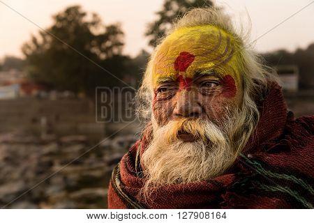 ORCHHA INDIA - JANUARY 29 2014: A Sadhu (holyman) at sunset near the Betwa river Orchha Madhya Pradesh state India.