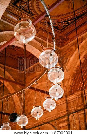 row of lamps indoor interior of muslim Ottoman Mosque of Muhammad Ali public monument also named Alabaster Mosque from year 1848 in Saladin old town in Cairo city Egypt Africa