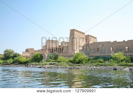 landscape from water Nile River of landmark Philae Temple ancient Egyptian public monument for the goddess Isis declared a World Heritage by Unesco in Agilkia island Egypt Africa