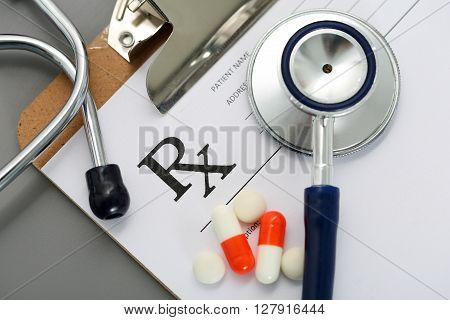 Prescription Lying On Clipboard Pad With Stethoscope