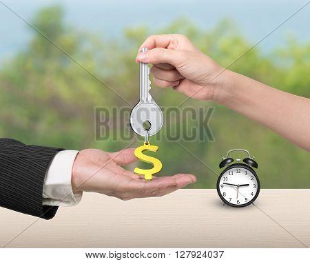 Woman Hand Giving Key Dollar Sign Keyring To Man Hand