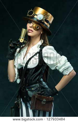 Portrait Of A Beautiful Steampunk Woman Holding A Gun