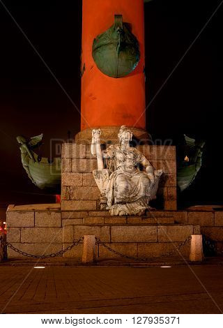 St. Petersburg. South rostral column. Female figure allegorically represents the river Neva. Night Photography. Earlier rostral column represented the Navy and served as a beacon of glory.