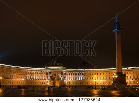 St. Petersburg. The General Staff building photographed at night.  Dual arch is topped with a Roman quadriga. In the Winter Palace and the Arch of the General Staff is the Alexander Column.