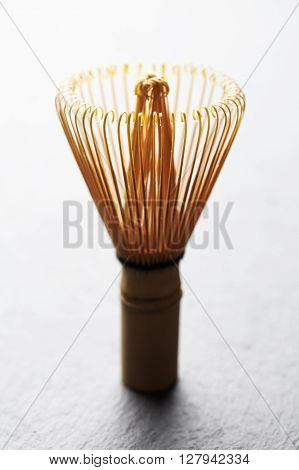 A chasen - special bamboo matcha tea whisk ** Note: Shallow depth of field