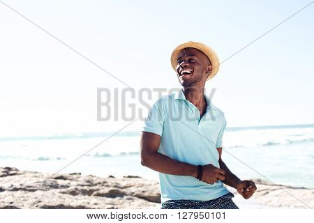 Cheerful Young African Man Enjoying At The Beach