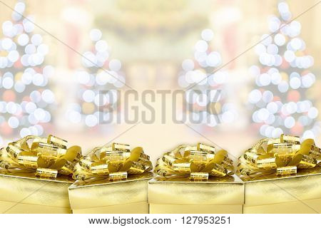 Many Golden Color Present With Blur Christmas Bokeh Light Background,leave Space To Adding Your Cont