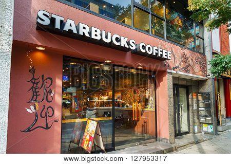 YOKOHAMA JAPAN - NOVEMBER 24 2015: Starbucks Coffe with a Chinese touch on a street of Yokohama Chinatown