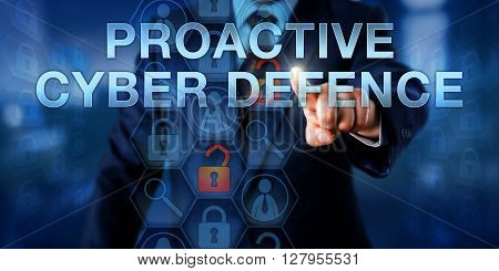 Investigator is touching PROACTIVE CYBER DEFENSE on a virtual interactive screen. Information technology concept and cyber security metaphor for pre-emptive actions opposing a computer attack.