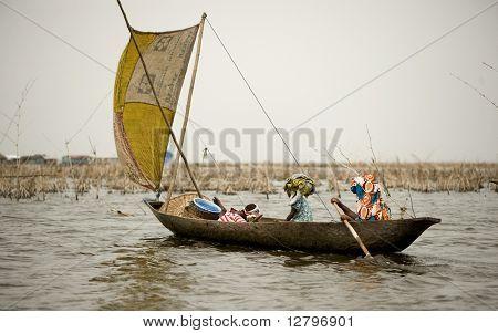 Women boating on the lagoon of the stilt village Ganvie in Benin.