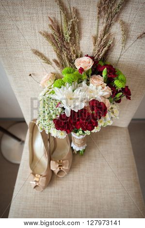 Bridal bouquet and bride shoes for wedding day