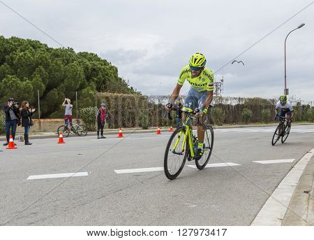 Barcelona Spain - March, 27 2016: The cyclists Alberto Contador of Tinkoff Team and Nairo Quintana of Movistar Team riding in the peloton during Volta Ciclista a Catalunya on the top of Montjuic in Bracelona Spain on March 27 2016. Quintana was the winner