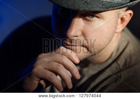 Portrait of a elegant young man in hat.