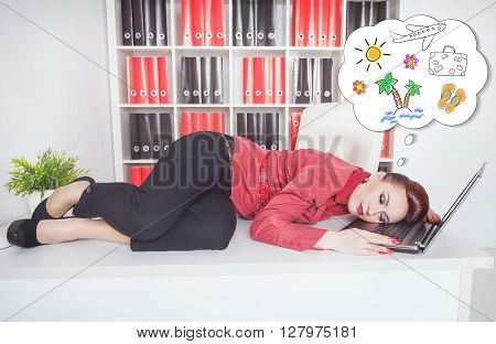 Businesswoman Sleeping On The Table And Dreaming About Vacation