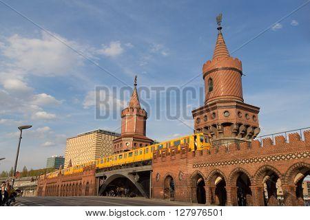 Berlin, Germany - april 30, 2016: Subway (U-Bahn) train crossing the Oberbaum bridge (Oberbaumbruecke) in Berlin, Kreuzberg.