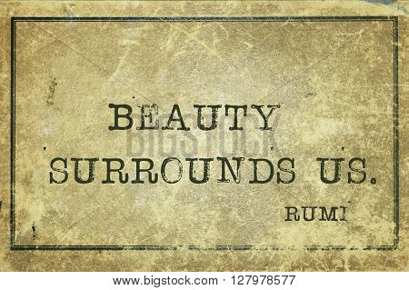 Beauty surrounds us - ancient Persian poet and philosopher Rumi quote printed on grunge vintage cardboard