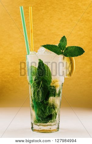 Mojito glass of water with lemon ice and mint