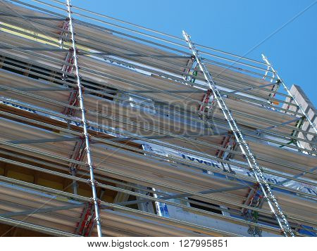 Safety scaffolding on a five story apartment construction project. ** Note: Shallow depth of field
