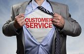 Businessman in classic superhero pose tearing his shirt open to reveal t shirt with customer service concept for assistance, contact us, helpdesk, helpline and business support poster